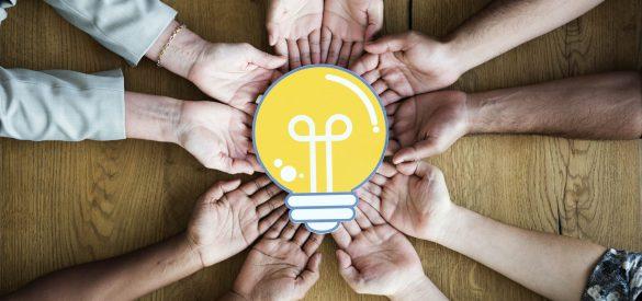 people-holding-light-bulb-min (1)